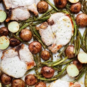 Pork Chops, Green Beans, and Potatoes all baked on one sheet pan.