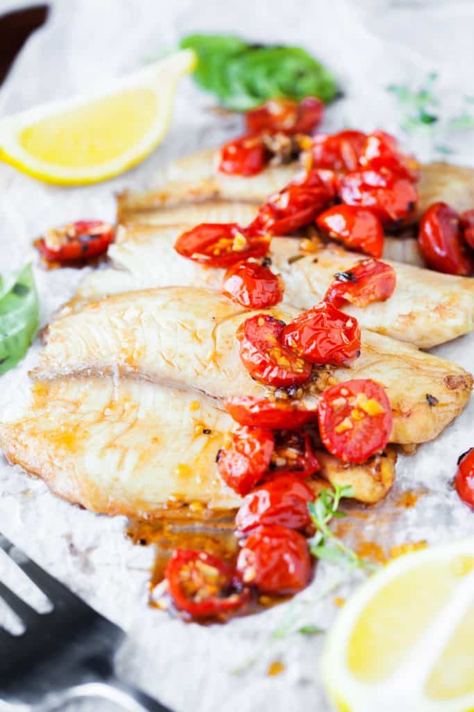 Balsamic Roasted Cherry Tomato Walleye on a Sheet Pan with Lemons on Fork
