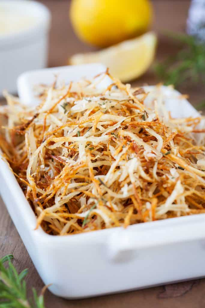 Baked Parmesan Rosemary Shoestring Fries are the perfect side dish!