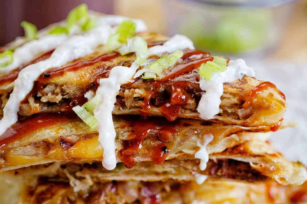 pulled pork quesadillas with bbq sauce and white sauce