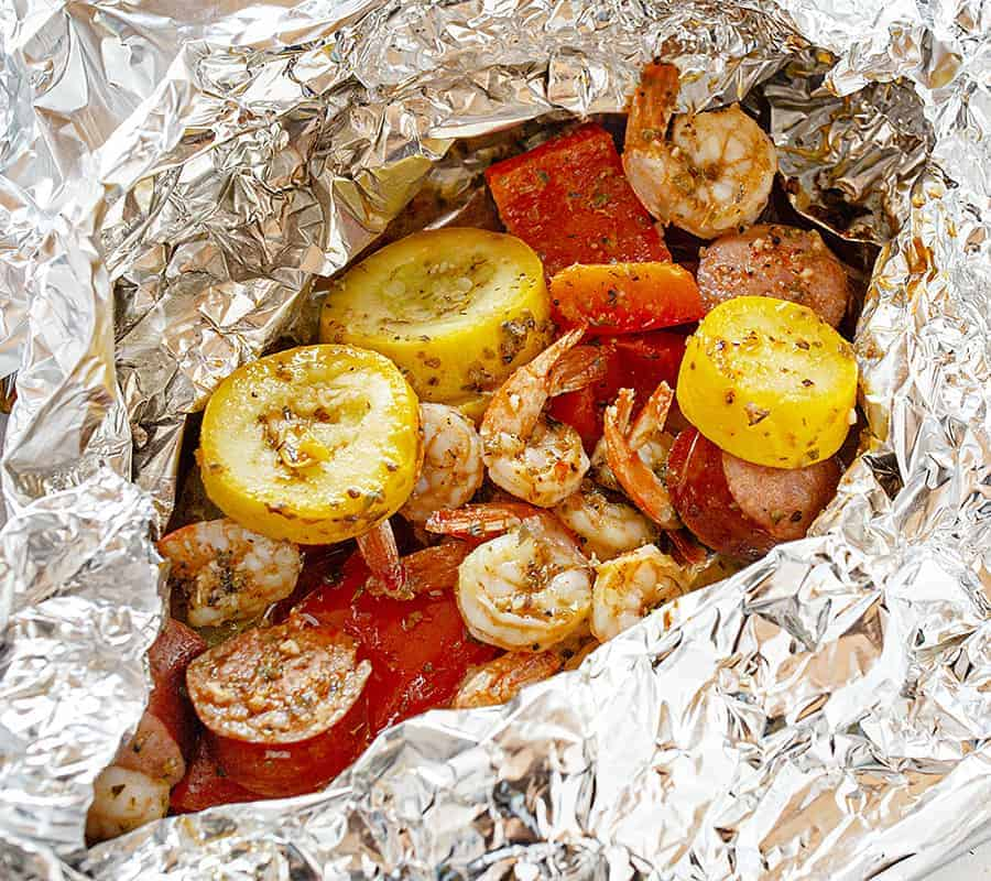 Opening foil pack of Grilled Shrimp and Sausage