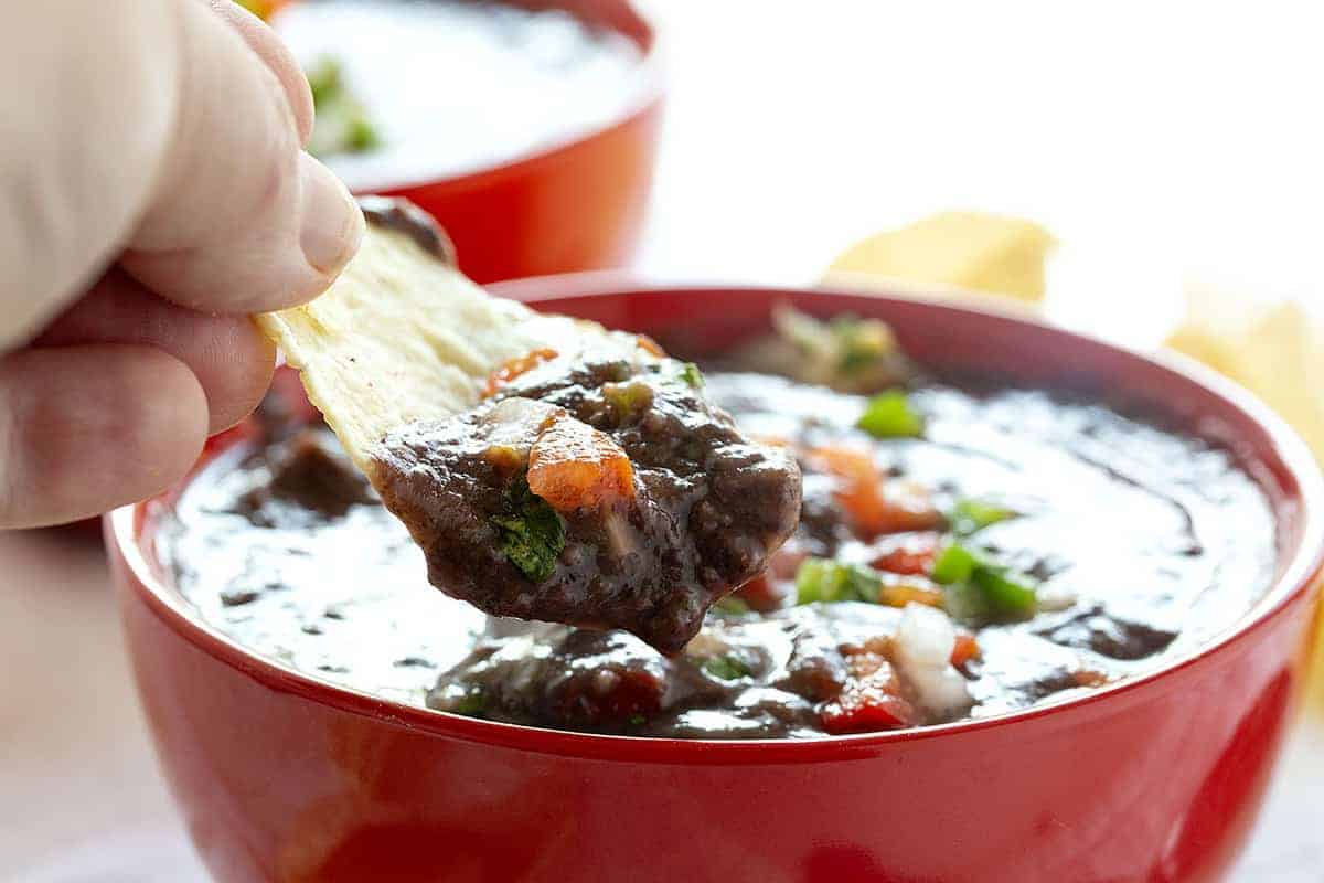 Chip dipped into Black Bean Soup