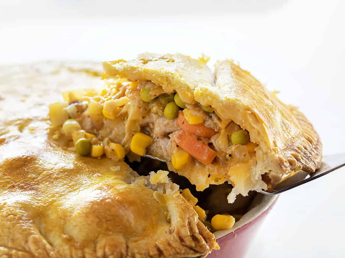 Removing a piece of Chicken Pot Pie from Pan