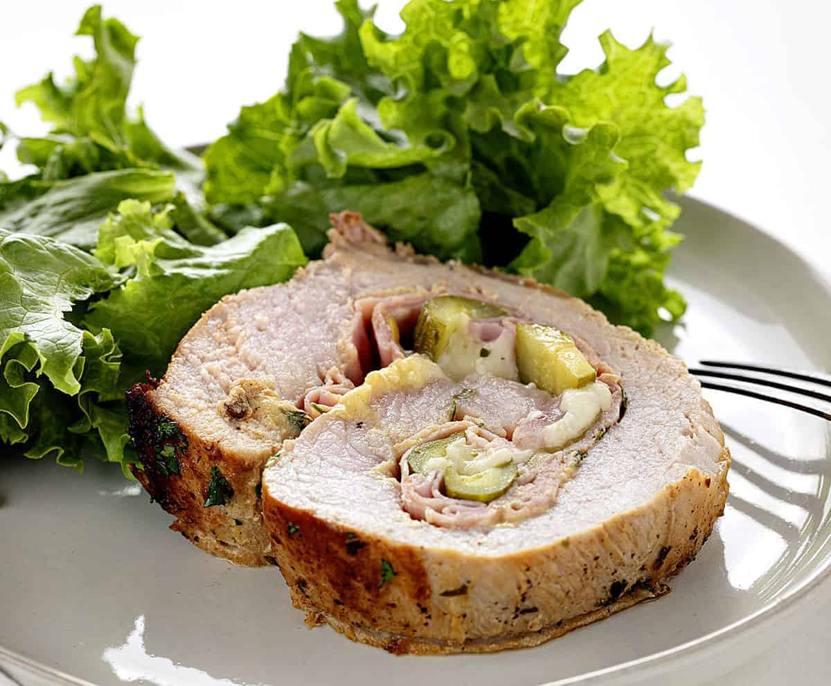 Slice of Cuban Pork Loin on a Plate with lettuce