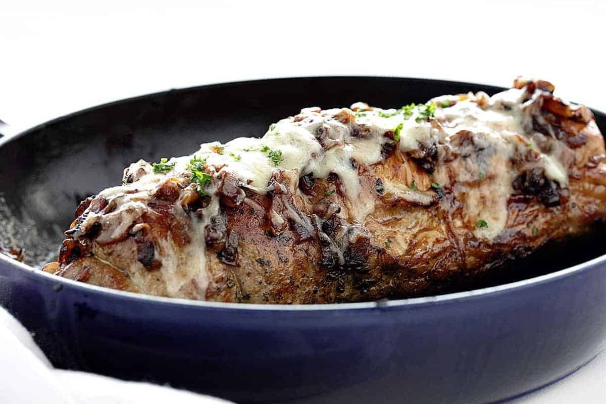 Whole French Onion Stuffed Pork Loin in a Skillet