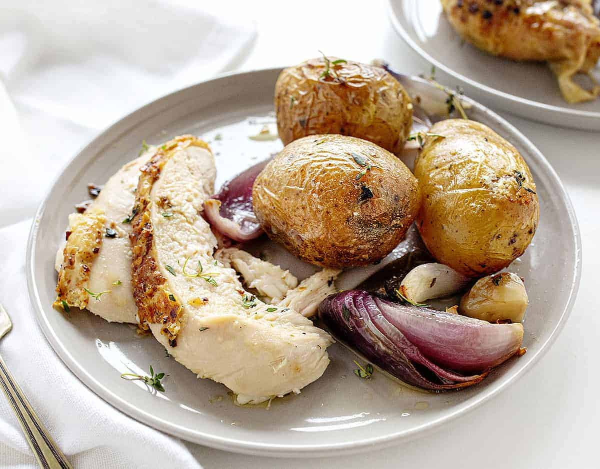 Plated Roasted Chicken with Potatoes, Onion, and Garlic