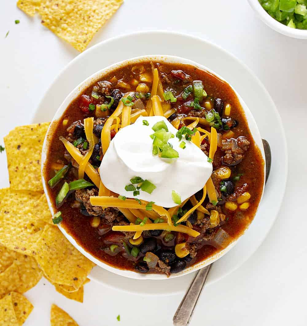 Overhead Bowl of Taco Chili with Sour Cream and Jalapenos