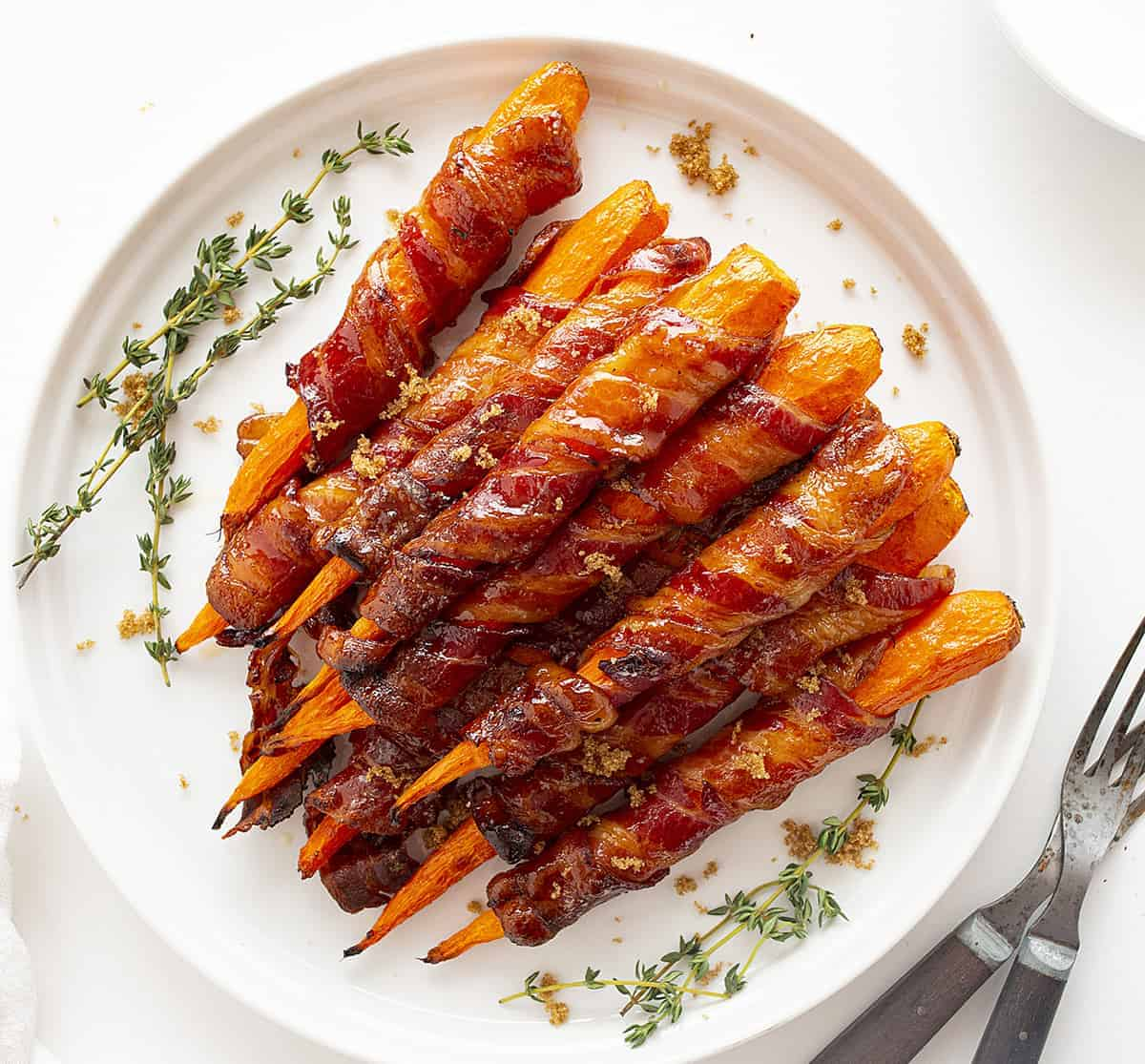 Overhead view of Maple Bacon Carrots on White Plate