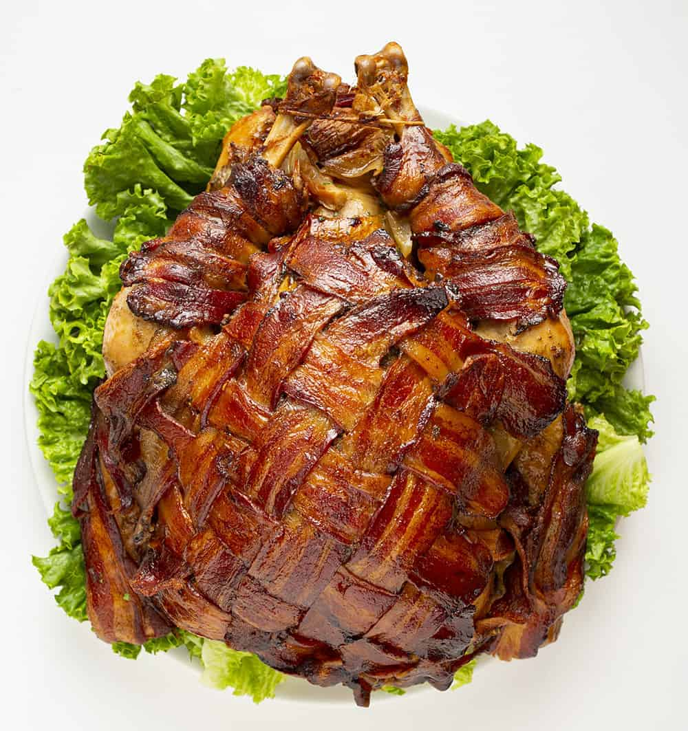 Whole, cooked, bacon wrapped turkey