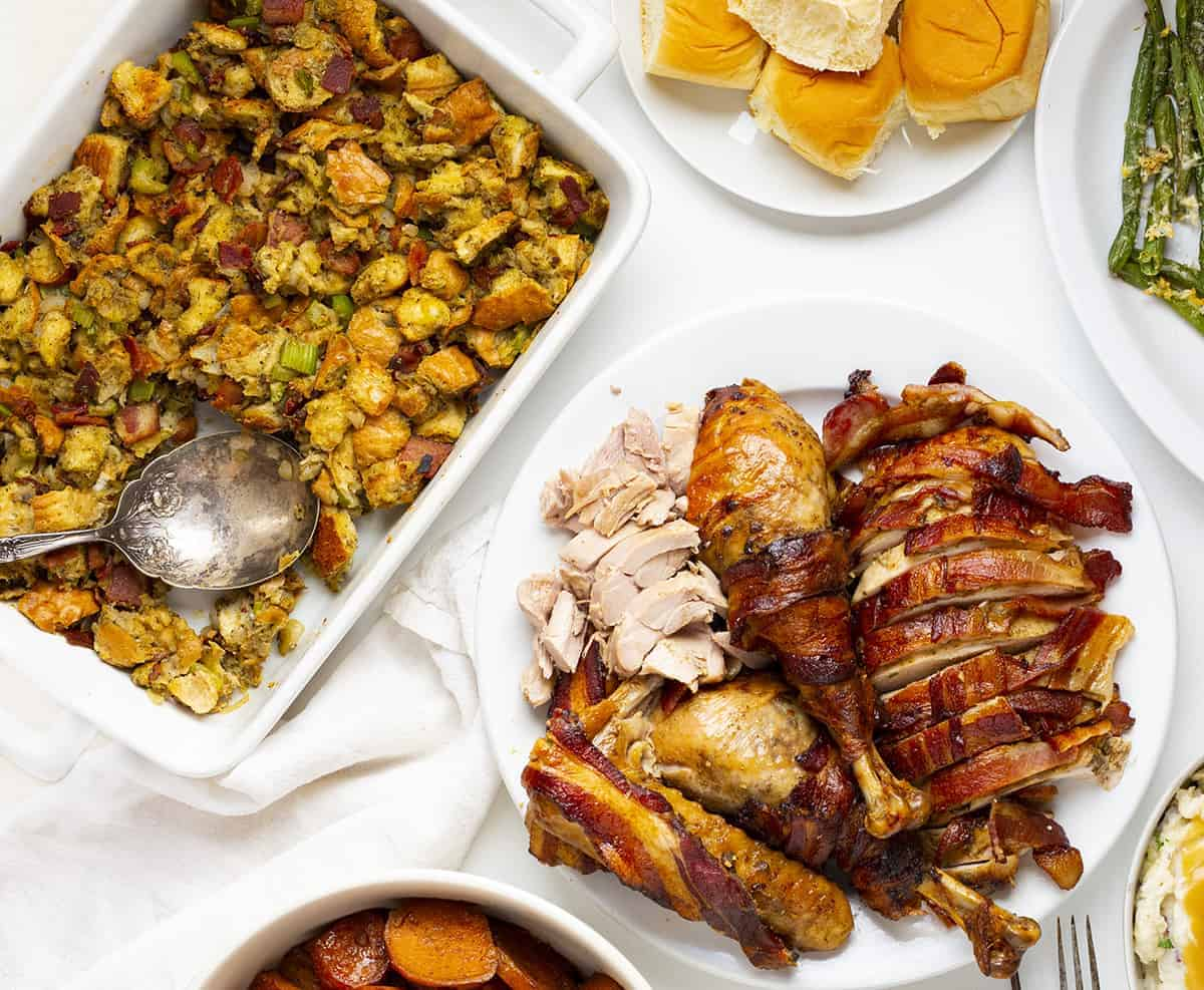 Overhead of Turkey Bacon Stuffing with Thanksgiving side dishes