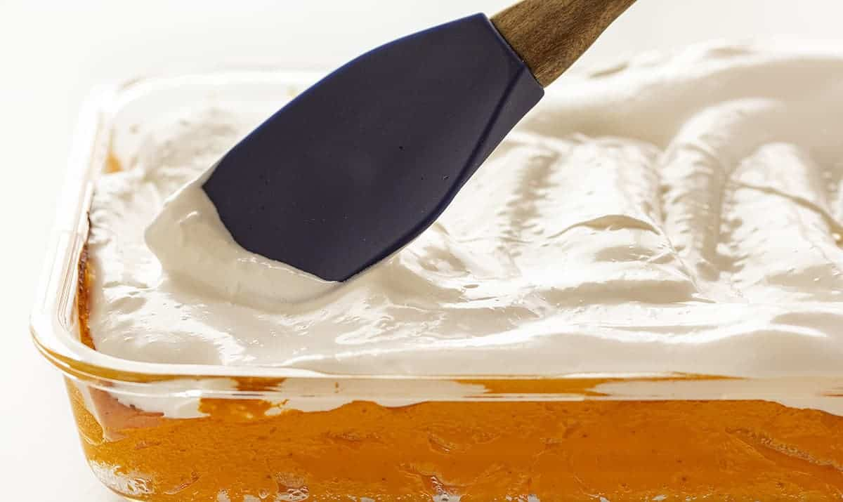 Spreading meringue over Sweet Potato Casserole