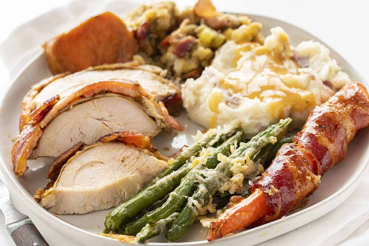 PLate of Thanksgiving fixings with Roasted Green Beans
