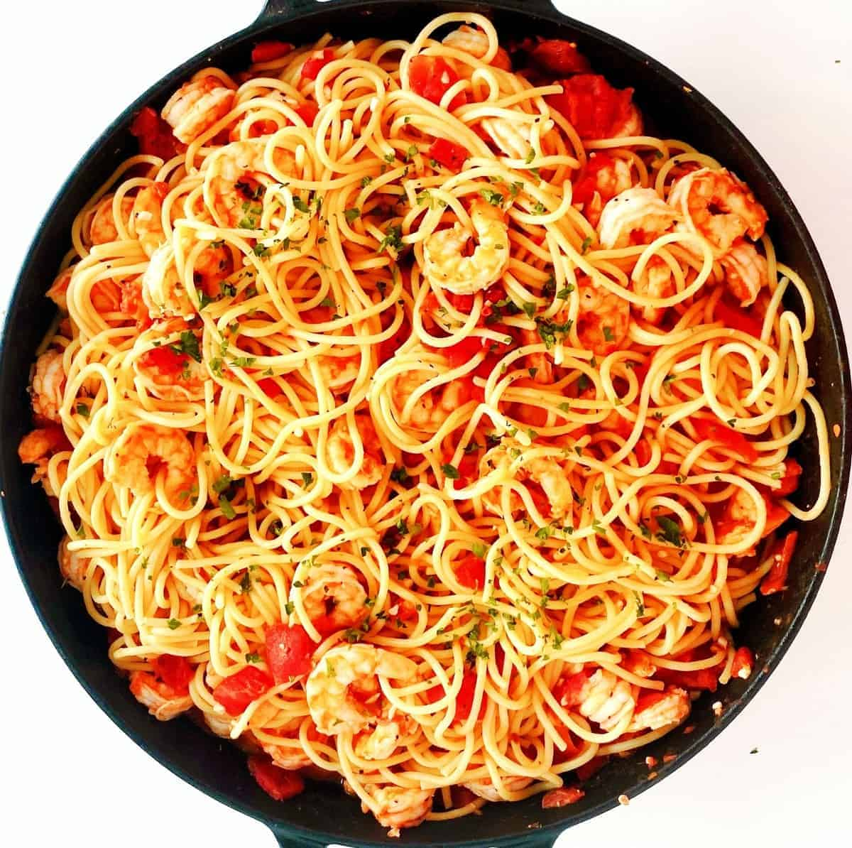 Overhead of Shrimp Pasta with Tomatoes in a large skillet