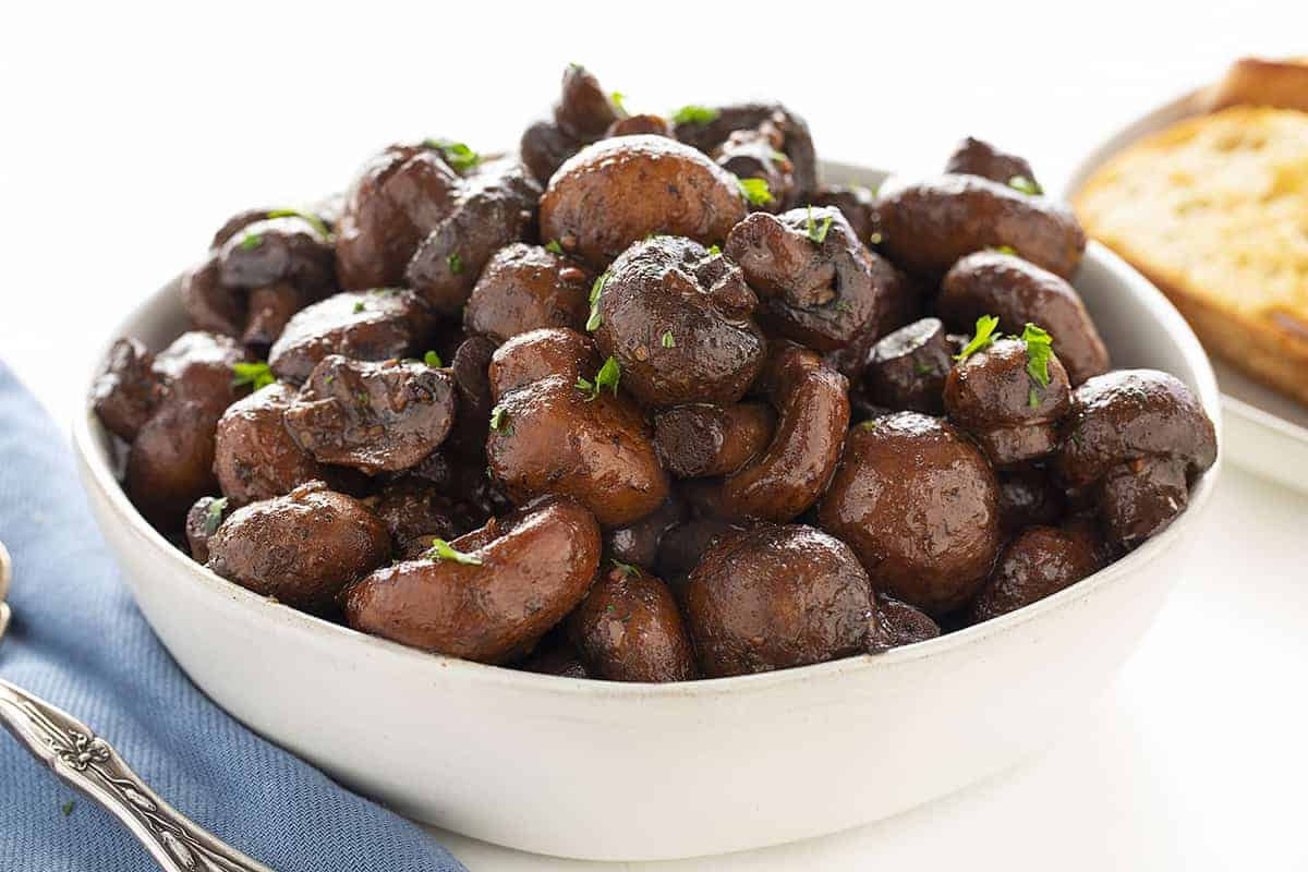 Burgundy Mushrooms in a White Bowl
