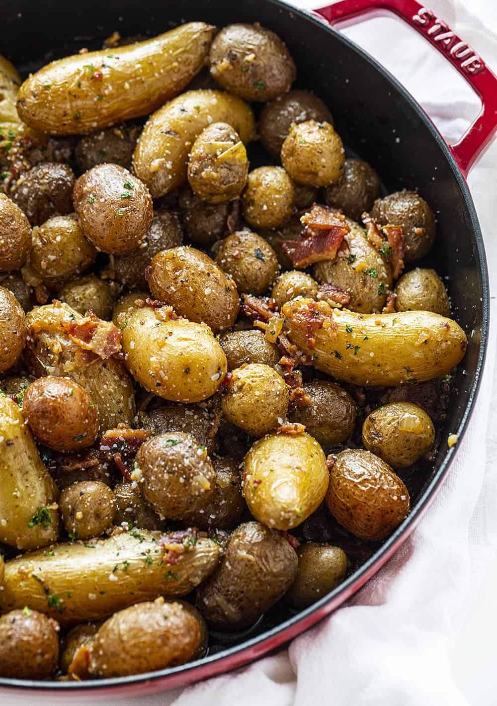 Roasted Potatoes with Bacon in a Red Skillet