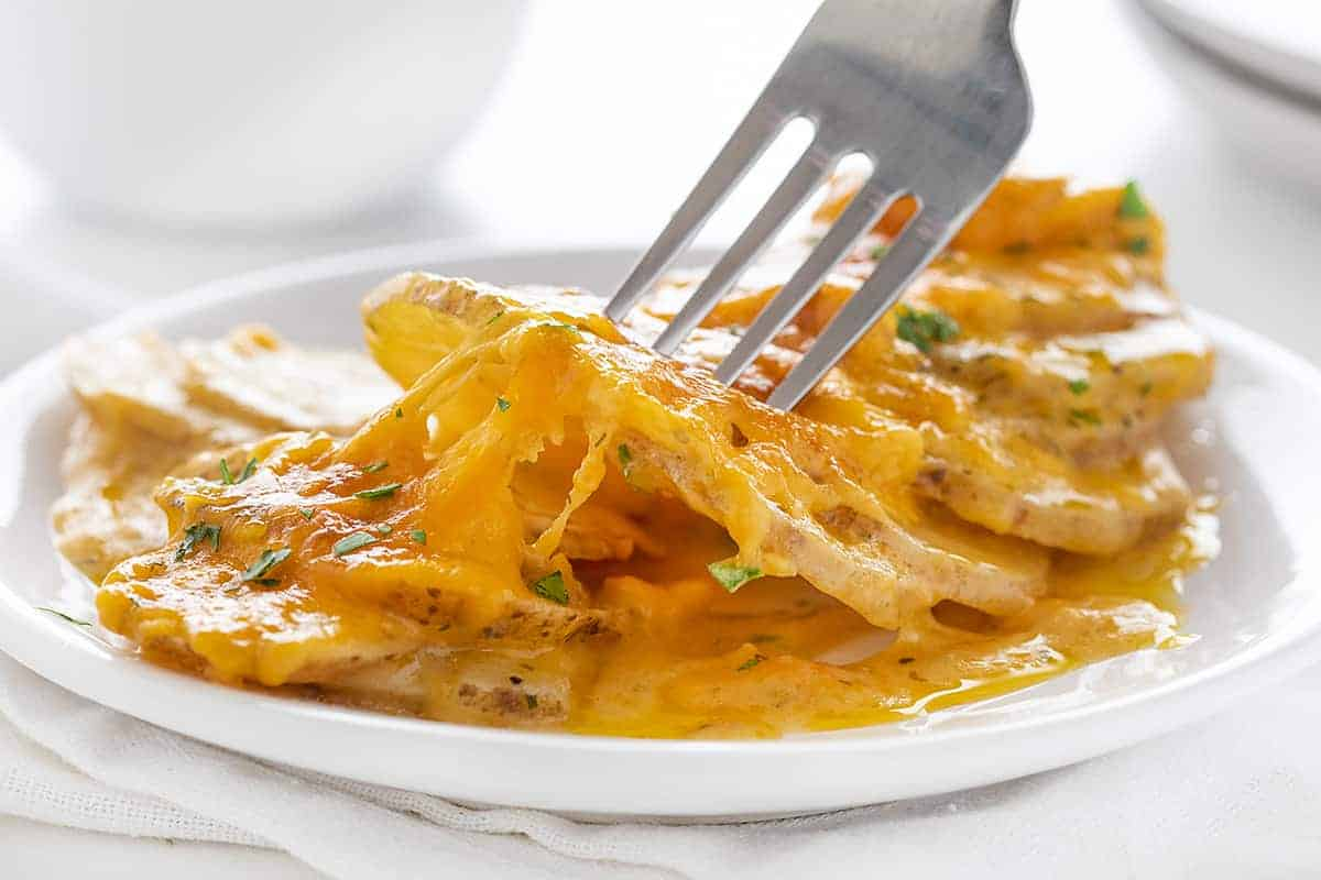 Fork of Cheesy Scalloped Potatoes with Ranch Seasoning