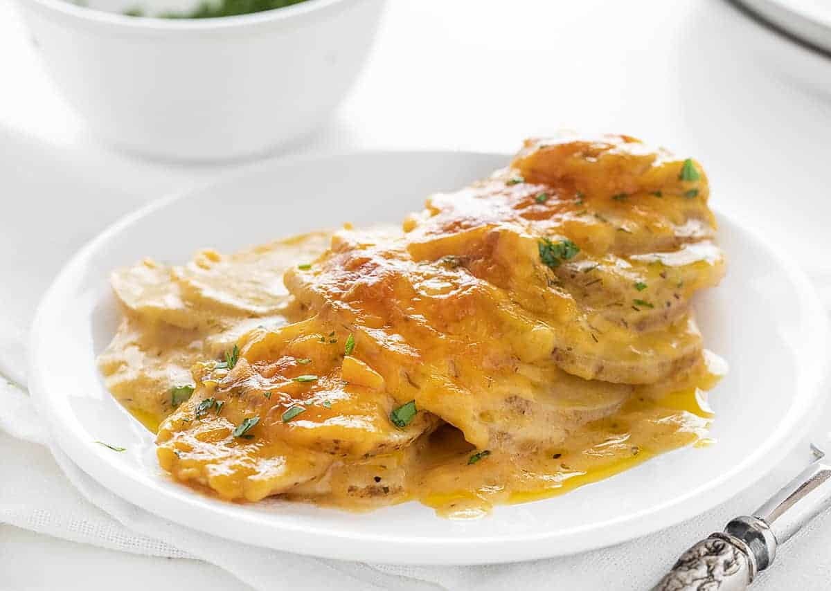 Plate of Scalloped Potatoes with Cheesy Ranch Sauce