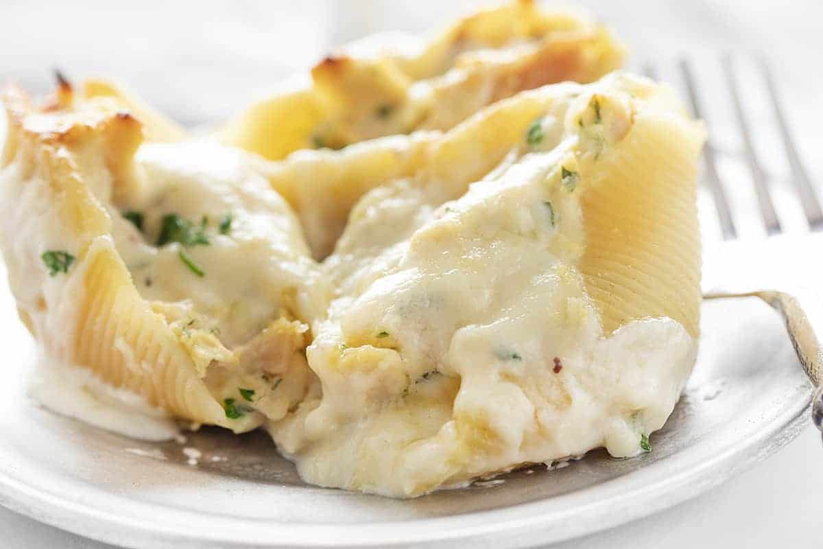 Three Chicken Alfredo Stuffed Shells Recipe on a Plate with Fork