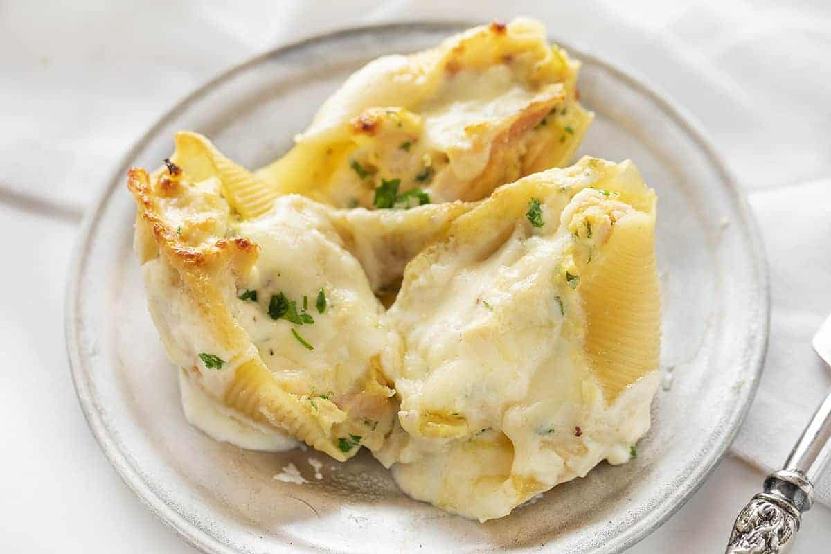 Three Chicken Alfredo Stuffed Shells on a Plate