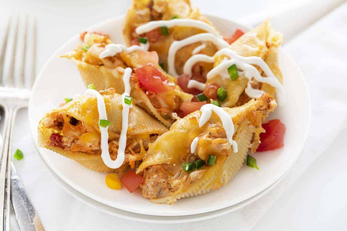 Chicken Taco Stuffed Shells on a White Plate with Fork