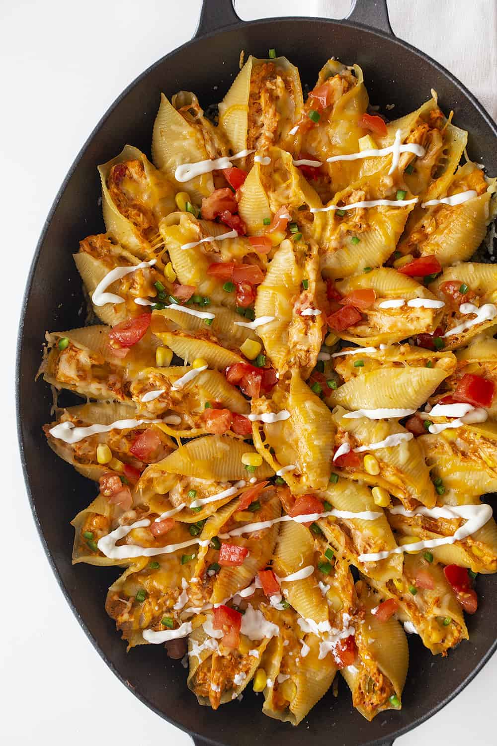 Overhead View is Chicken Taco Stuffed Shells in a Skillet