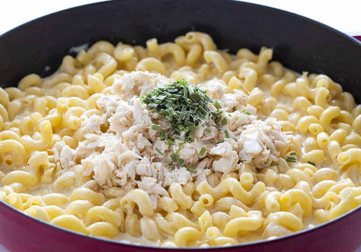 Macaroni and Cheese with Crab Being Added to Skillet