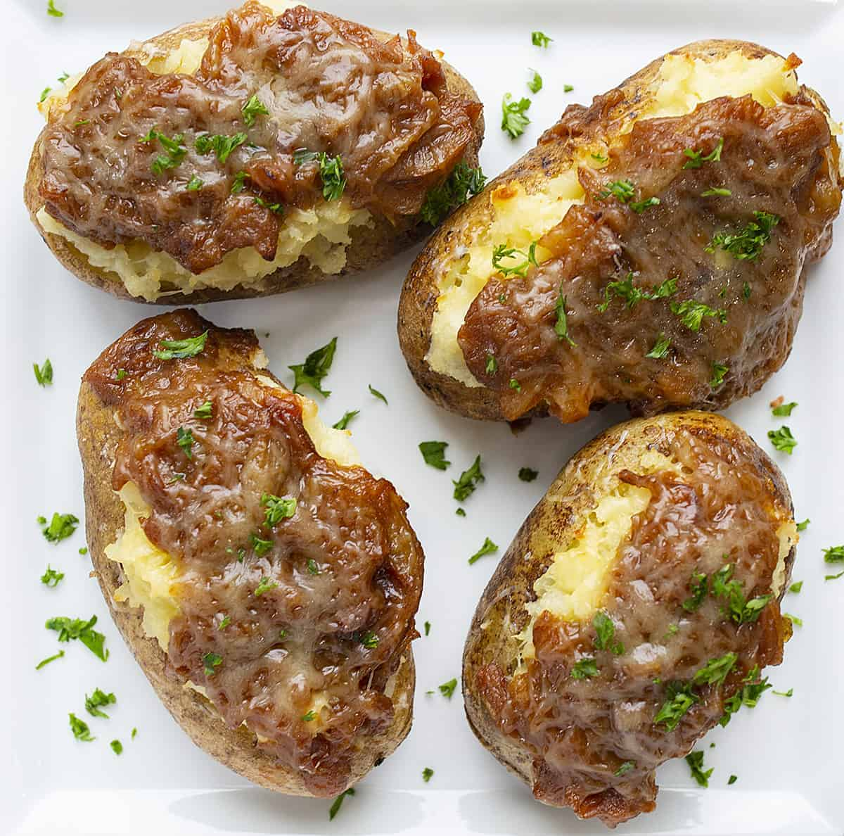 Overhead of French Onion Twice Baked Potatoes on White Plate