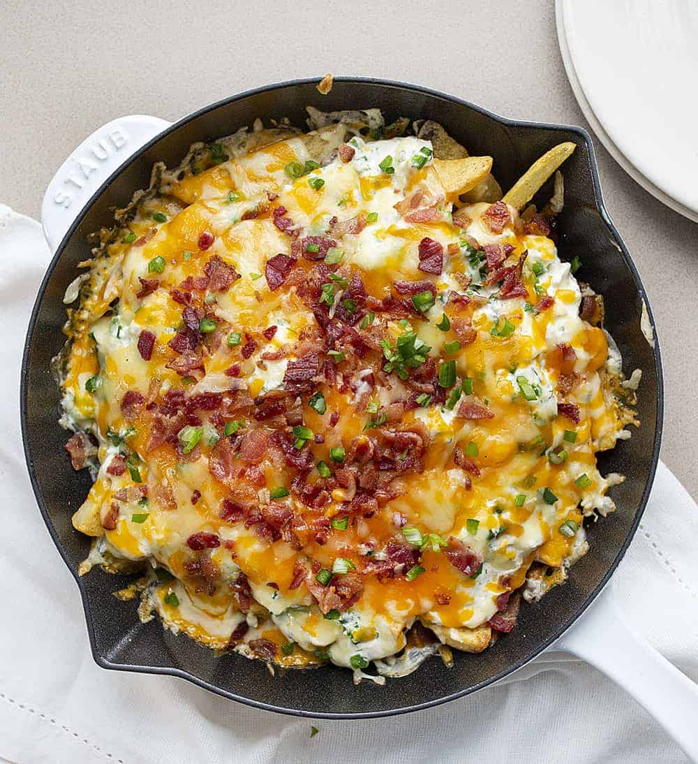 Overhead Image of Jalapeno Popper Cheese Fries in a White Skillet
