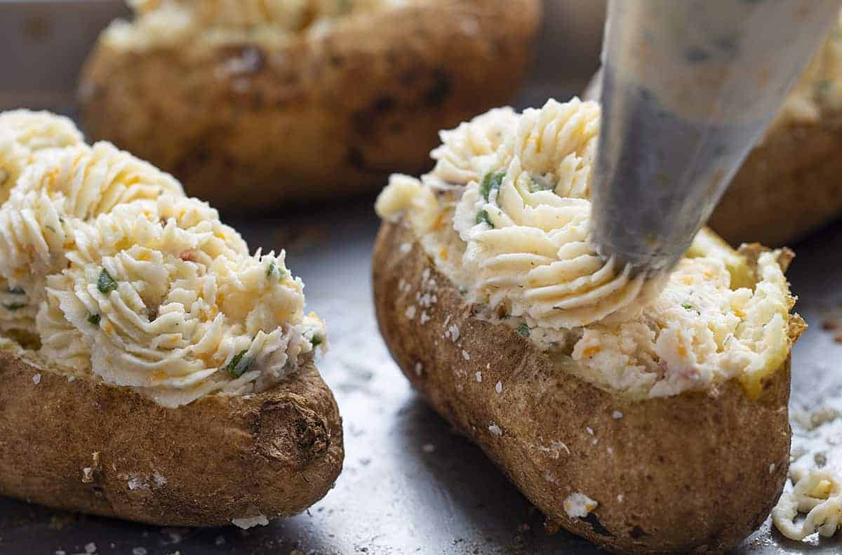 Filling Jalapeno Popper Twice Baked Potatoes with the Filling