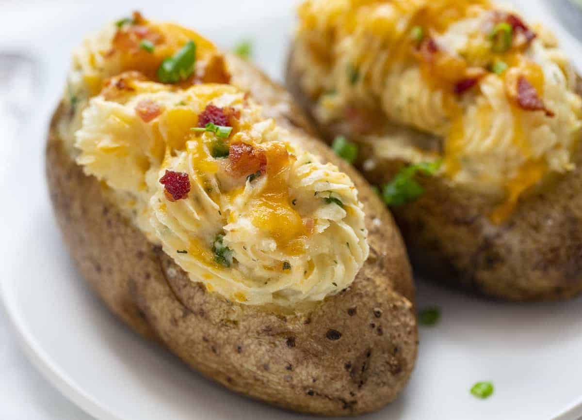 Two Jalapeno Popper Twice Baked Potatoes on a White Plate