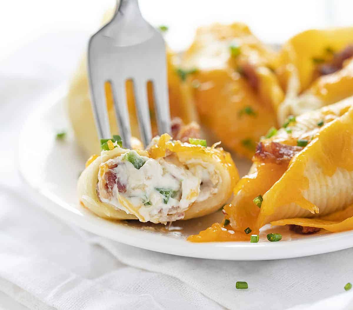 Fork Picking Up Cut Into Jalapeno Popper Stuffed Shells