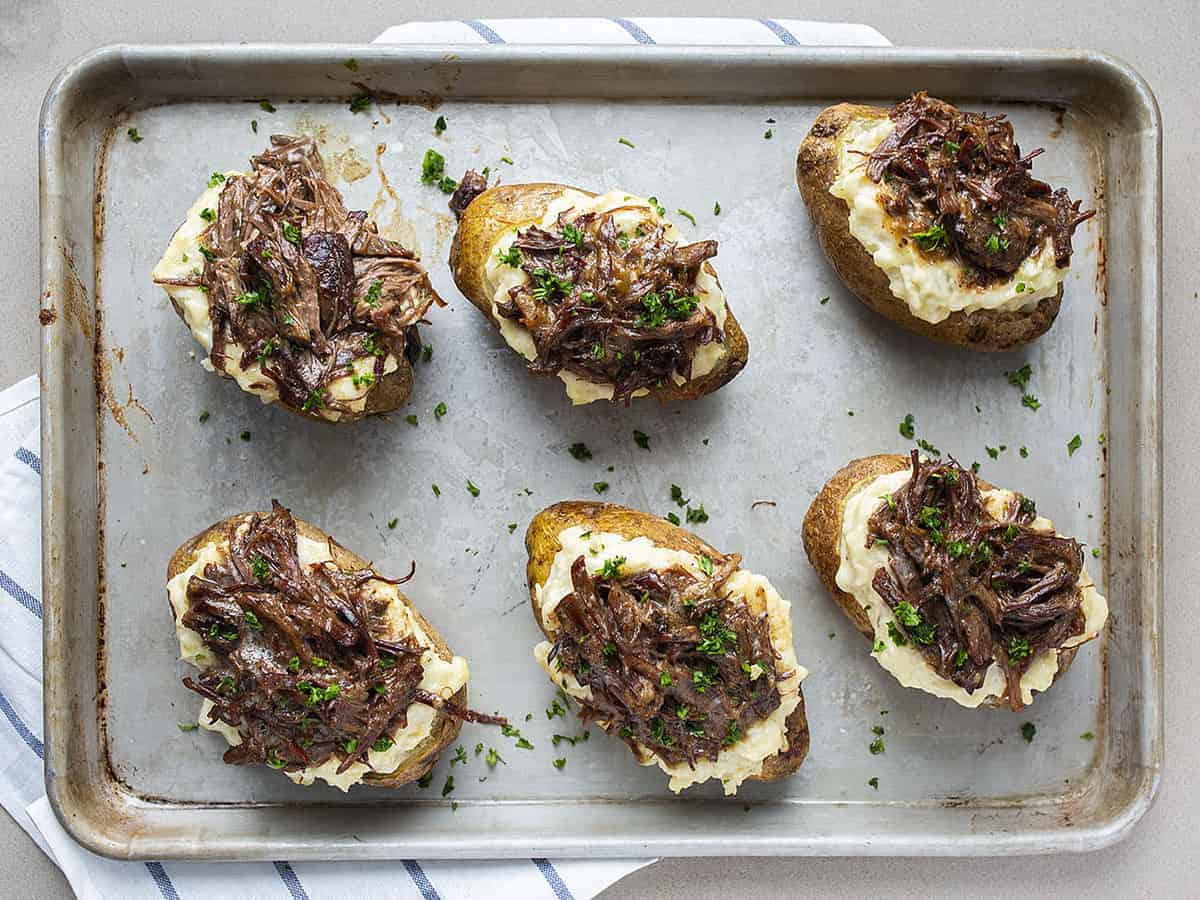 Overhead view of Pot Roast Twice Baked Potatoes on Sheet Pan