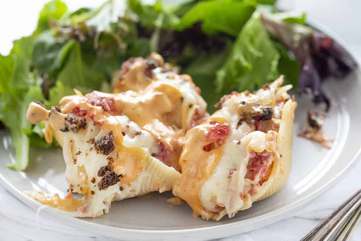 Reuben Stuffed Shells on Plate with Greens