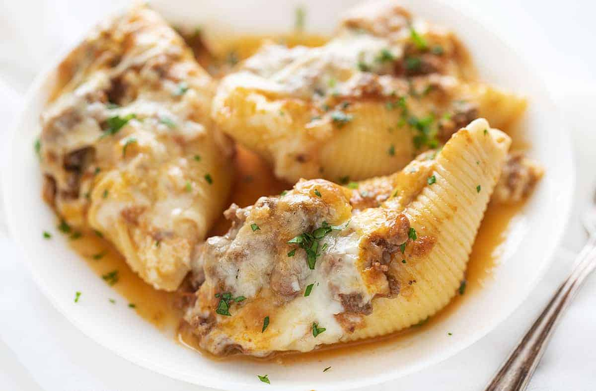 Three Cheese Stuffed Shells on A White Plate