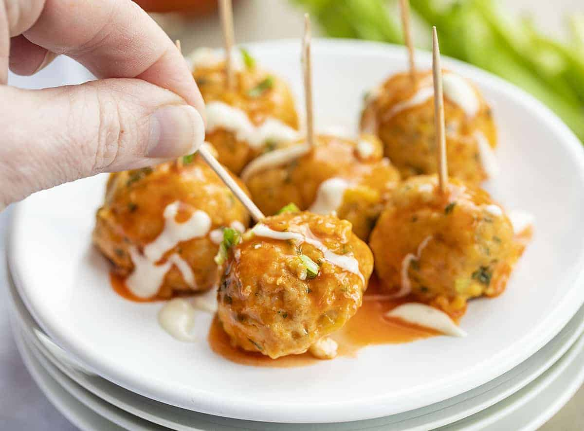 Buffalo Chicken Meatballs on a Toothpick on White Plate