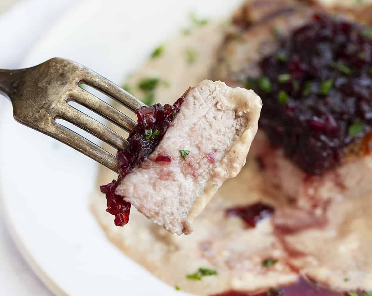 One piece of Cherry Pork Chop on a Fork