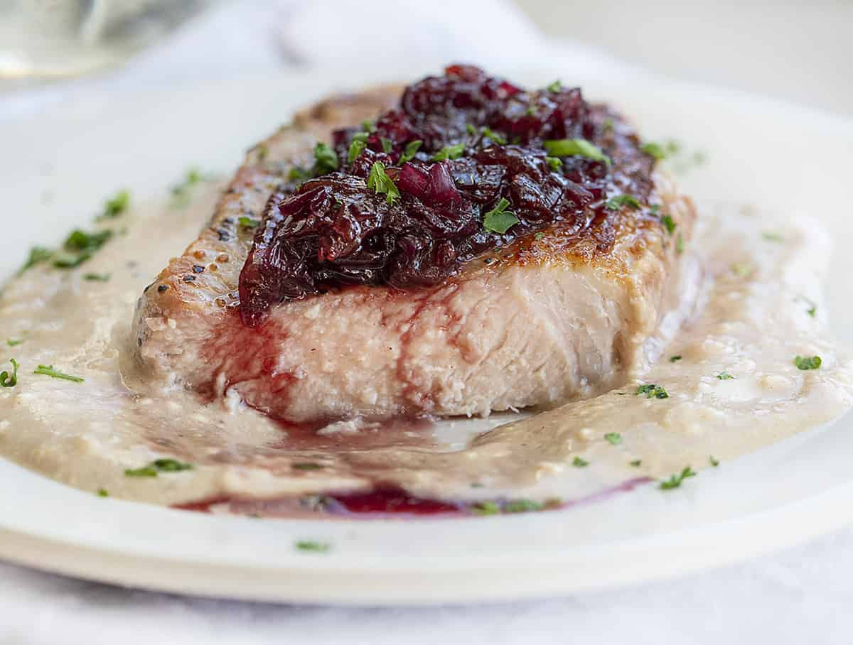 Cut into Cherry Pork Chops on a Plate with Sauces