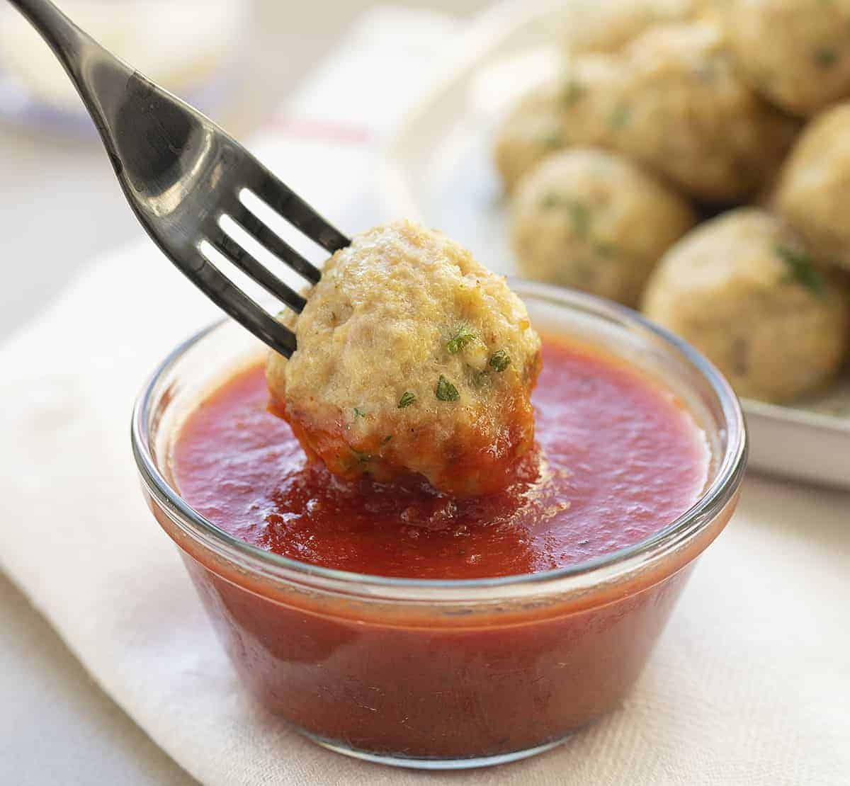 Dipping Chicken Meatball in Marinara