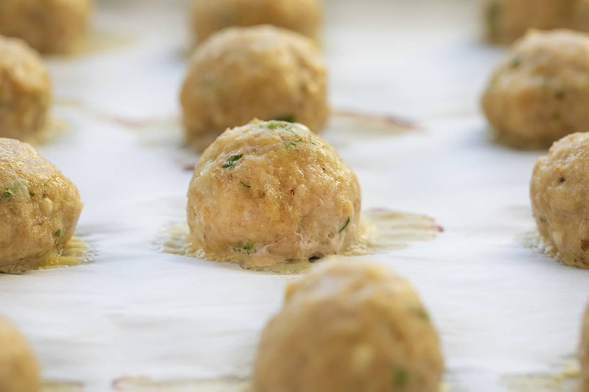 Baked Chicken Meatballs on Sheet Pan Close up view