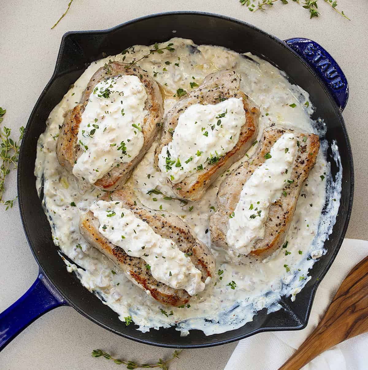 Cream Cheese Pork Chops in Blue Skillet Shot from Overhead