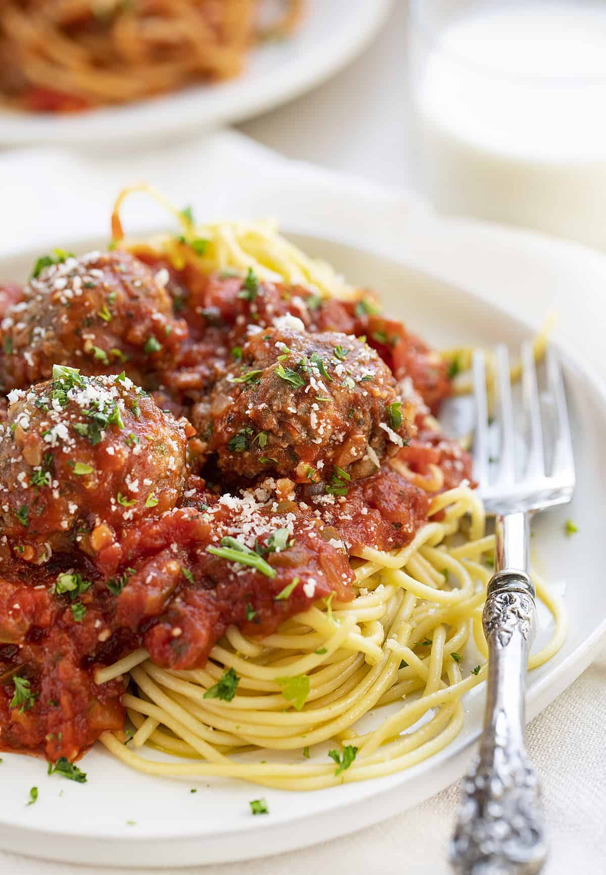 Plate of Spaghetti and Meatballs with Fork and Milk