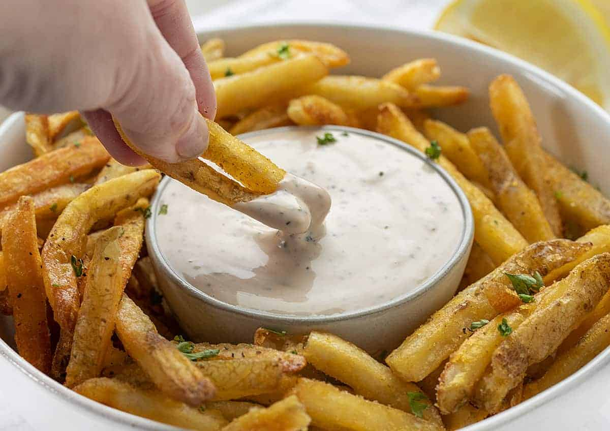 Dipping French Fries into Aioli