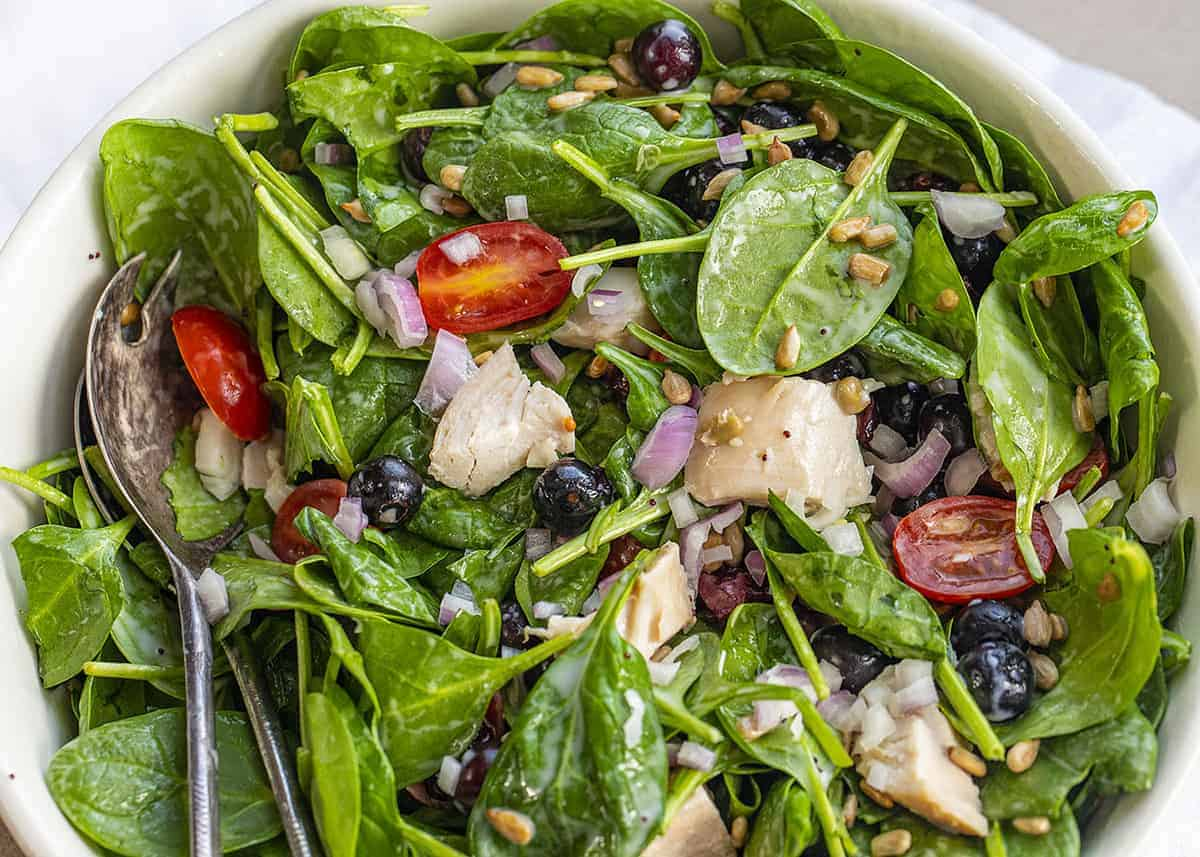 Close up of Blueberry Spinach Salad with Salad Forks