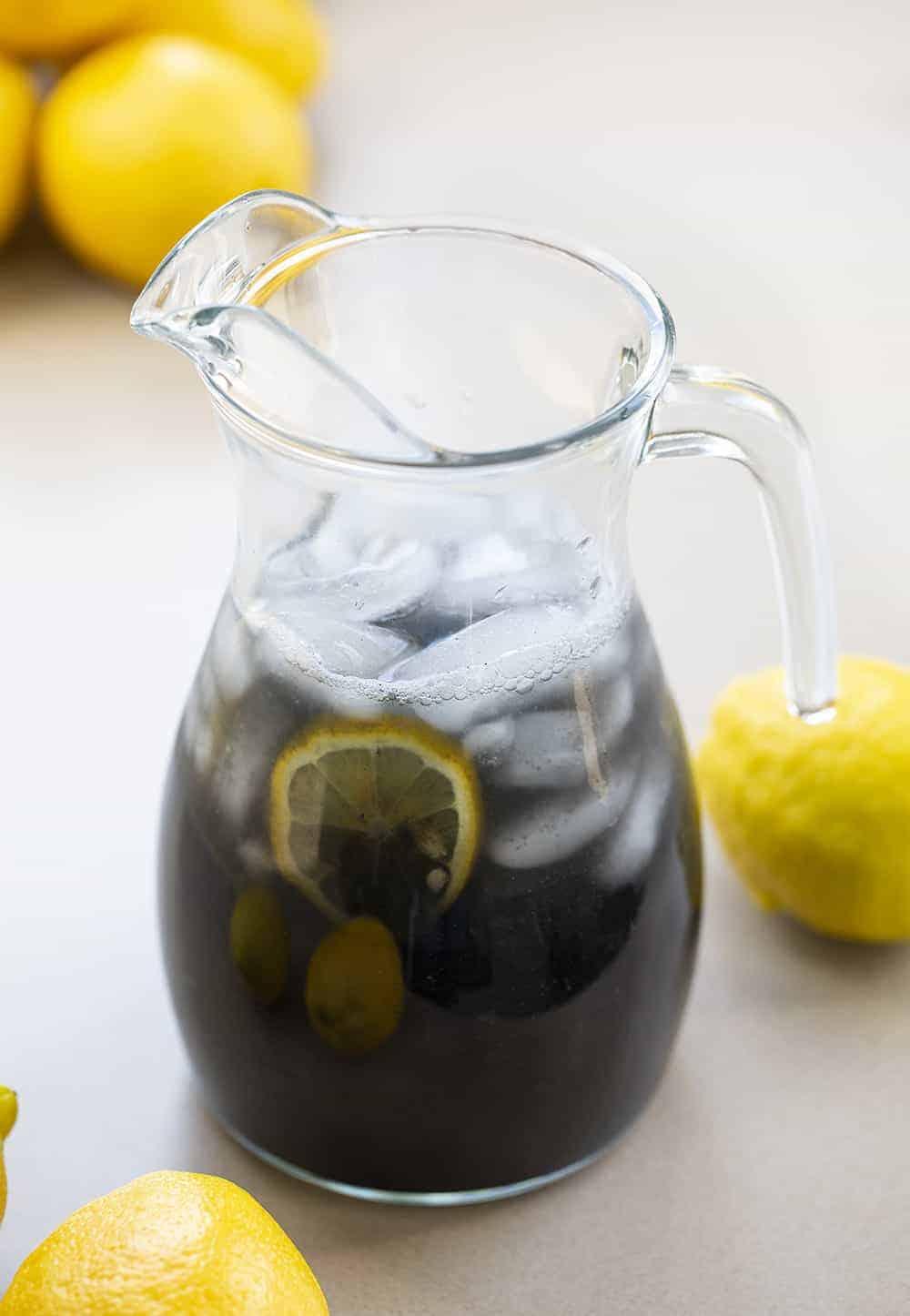 Pitcher of Charcoal Lemonade with Lemons