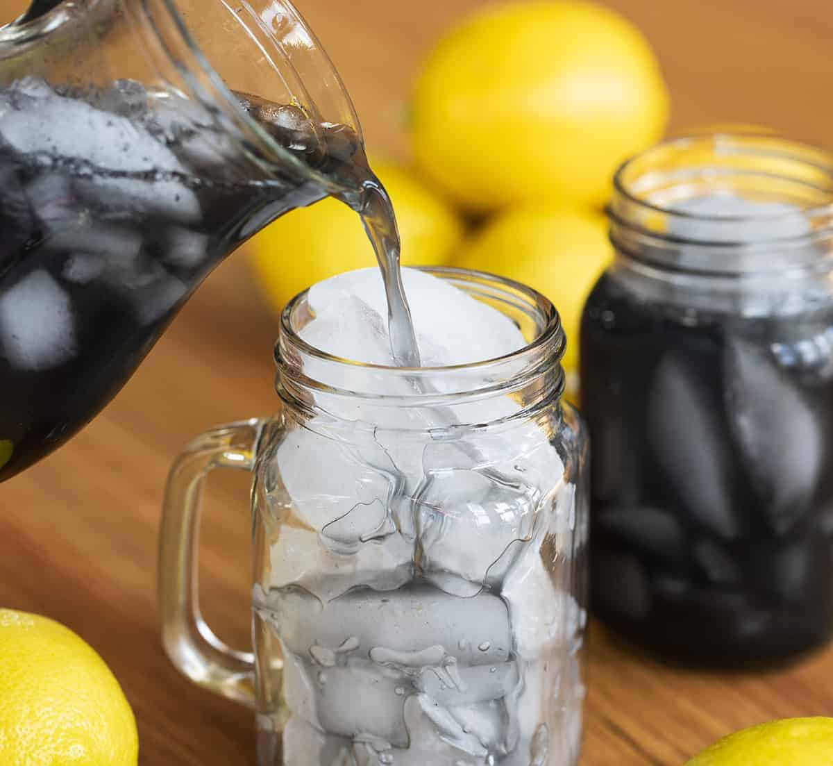 Pouring Charcoal Lemonade into Glass