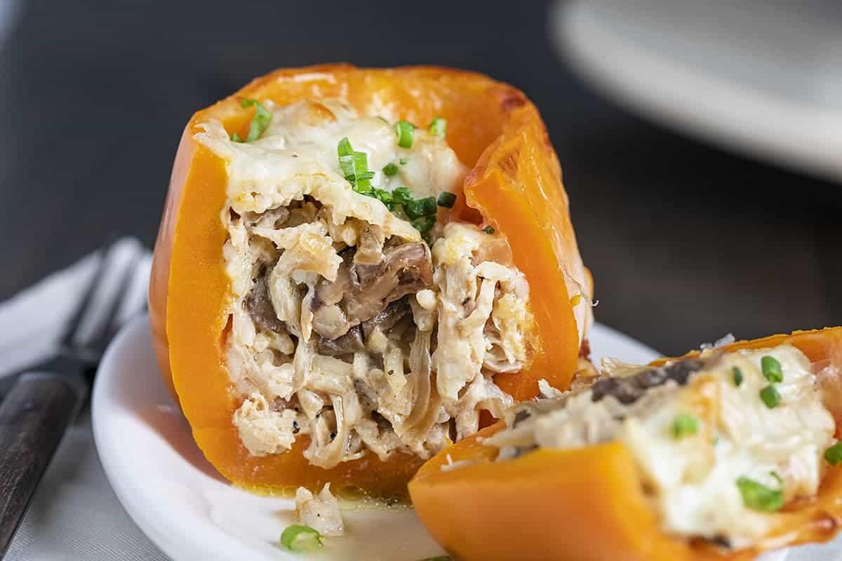 Cut Into Chicken Mushroom Stuffed Pepper on White Plate