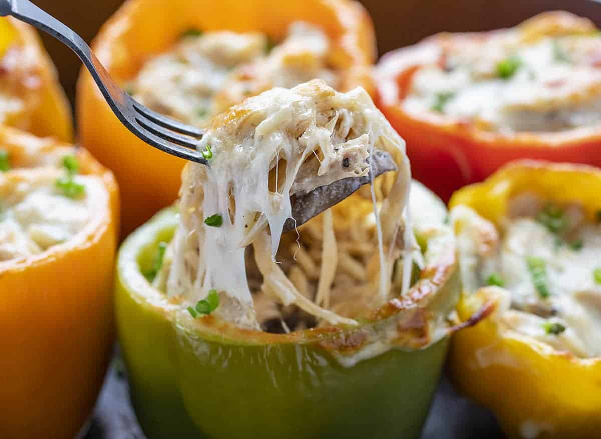 Fork Lifting Up Cheesy Chicken Mushroom Stuffed Peppers