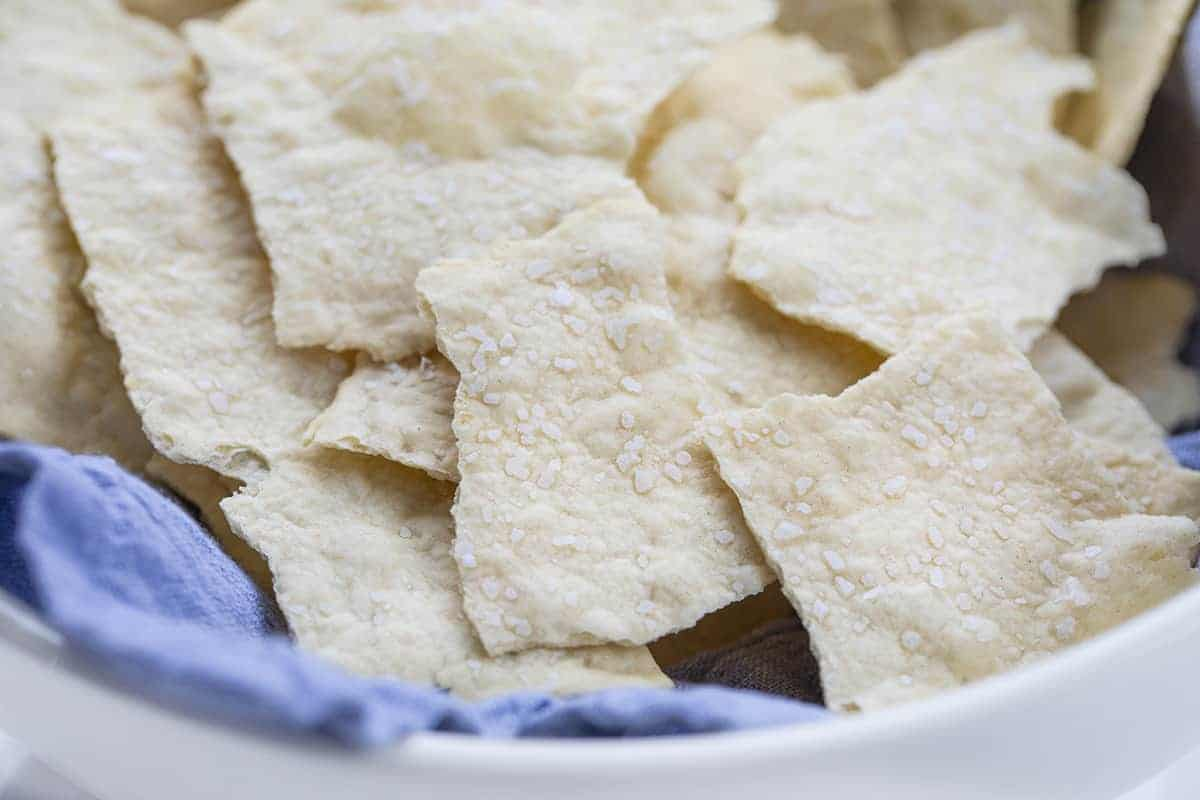 Homemade Sourdough Crackers in a Bowl with Blue Towel