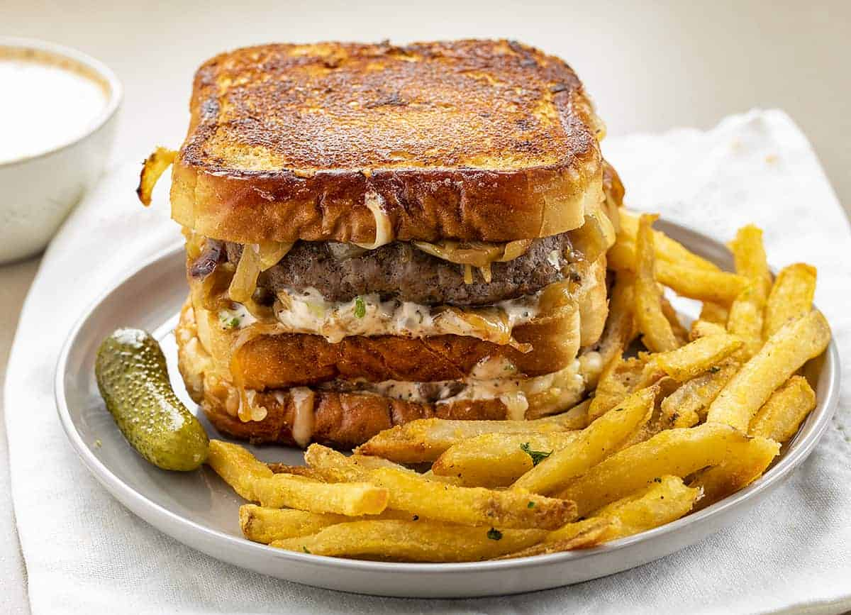 Double Decker Patty Melt on Plate with Fries and Pickle
