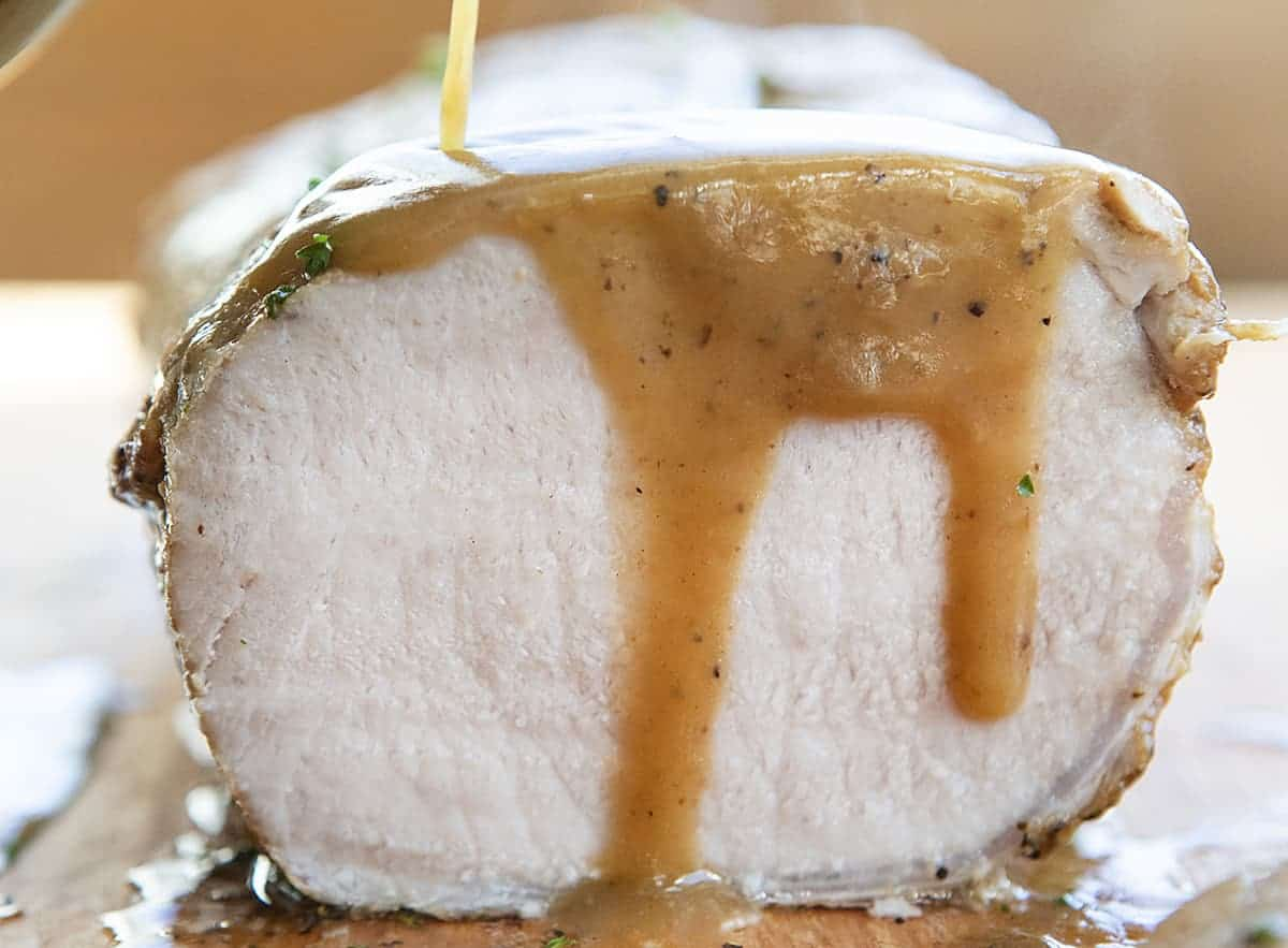 Pouring Gravy over Roasted Pork Loin